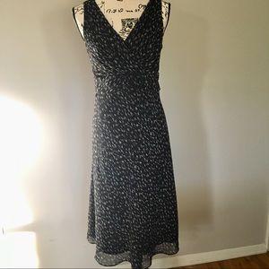 Ann Taylor wrap top floral chiffon dress. Black